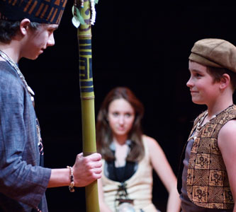 Tavana Nui (Willie Casper) meets his son Mafatu (Sam Pearson), as Kana (Rachel Ravel) looks on.